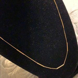 Skinny gold tone vintage style necklace